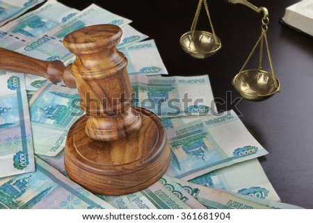 Concept For Corruption, Bankruptcy, Bail, Crime, Bribing, Fraud. Judges Gavel, Scale Of Justice, Old Law Book And Russian Cash On The Rough Black Wooden Textured Table Background. - stock photo