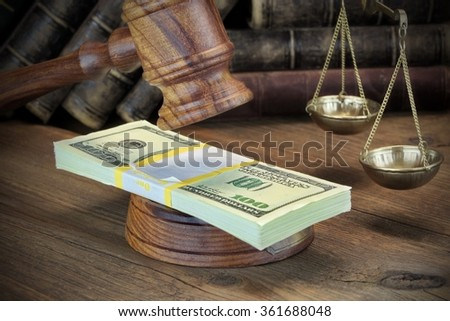 Concept For Corruption, Bankruptcy Court, Bail, Crime, Bribing, Fraud, Judges Gavel, Sound Block And Bundle Of Dollar Cash On The Rough Wooden Textured Table Background. - stock photo