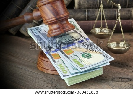 Concept For Corruption, Bankruptcy Court, Bail, Crime, Bribing, Fraud, Judges Gavel, Soundboard And Bundle Of Dollar Cash On The Rough Wooden Textured Table Background. - stock photo