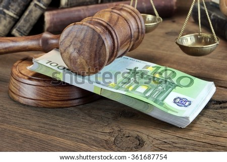 Concept For Corruption, Bankruptcy Court, Bail, Crime, Bribing, Fraud.  Judges or Auctioneer Gavel And Bundle Of Euro Cash On The Rough Wooden Table. Top View - stock photo