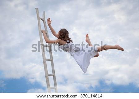 concept for effort, determination, escape, flight, escape, woman with ladder - stock photo