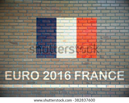 Concept for Euro 2016 France football championship.France flag paint on brick wall - stock photo