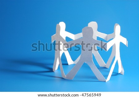 concept for friendship friends team teamwork love and help with paper man - stock photo