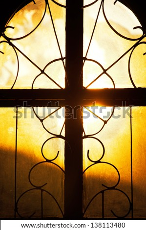 Concept for seeing the light, as light streams through Church window , Holy Cross   - stock photo