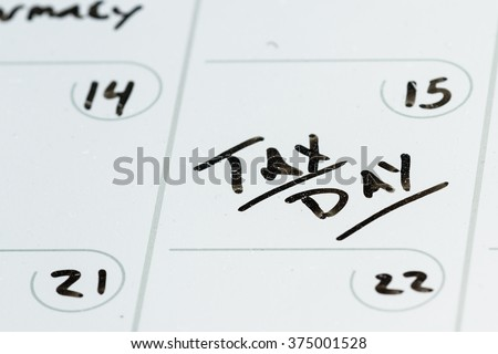 concept for tax day or april 15 the national deadline for filing taxes - stock photo
