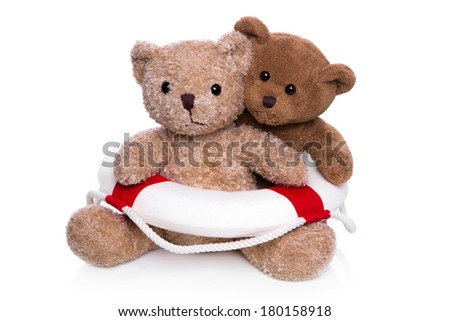 Concept for teamwork - two isolated teddy bears with a lifebelt. - stock photo