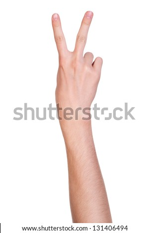 Concept for victory sign made with hand isolated on white background