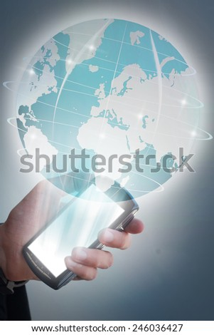 concept global connection, businessman with cell phone displaying hologram