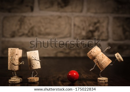 Concept going bowling with wine cork figures - stock photo
