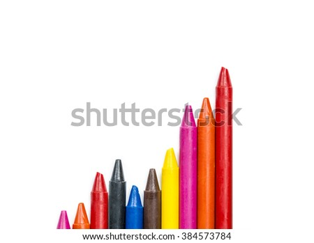 concept growing up concept , colorful oil pastel crayons on white background - stock photo