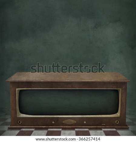 Concept grunge textured background with old vintage TV - stock photo