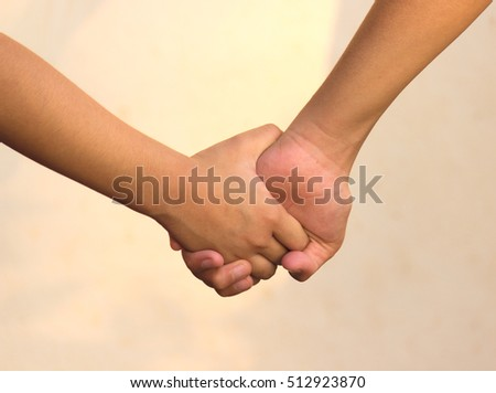 concept,hand in hand,Holding hands together.
