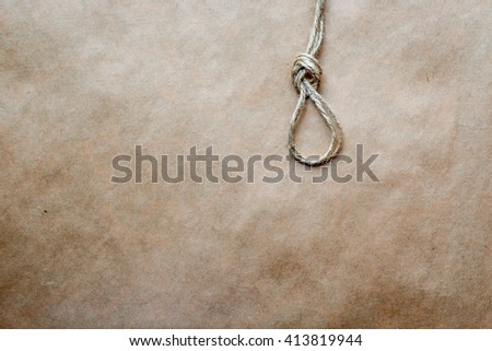 concept hangman's knot on kraft paper background - stock photo