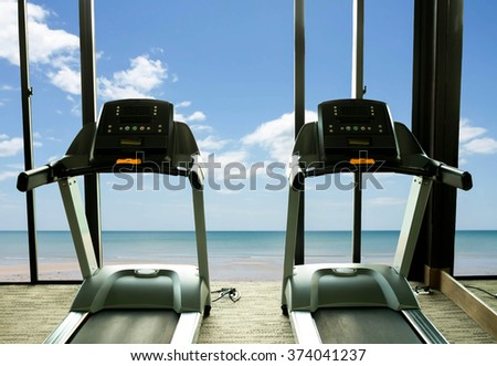 Concept health care Treadmill in Fitness gym beach front view
