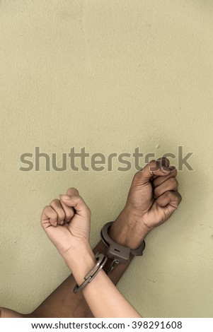 concept human trafficking, hand young man and girl in shackle and leave space for adding your content. background look old or vintage style. (vintage color tone) - stock photo