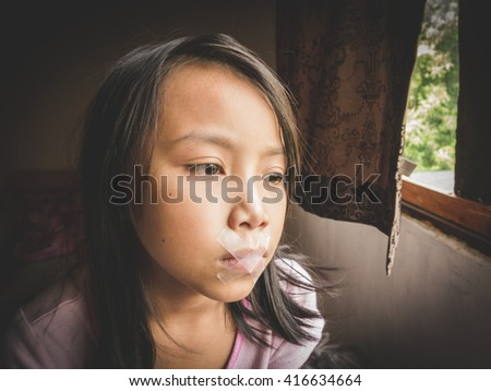 Concept Idea, Little kid was gagged with plastic tape. Vintage Filter Effect - stock photo