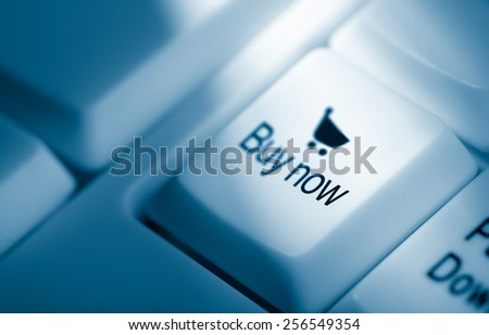 concept image, buy now with shopping cart icon on computer keyboard - stock photo