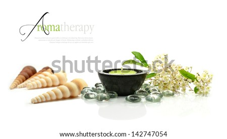 Concept image depicting aromatherapy treatments with fresh flowers and aromatic candle against a clean white surface. Copy space. - stock photo