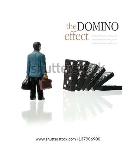 Concept image depicting the domino effect in business for example unemployment or retirement. Copy space. - stock photo
