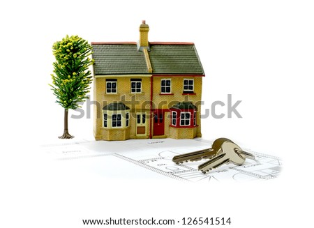Concept image for new home with floor plans and shiny house keys on a white background. Copy space. - stock photo