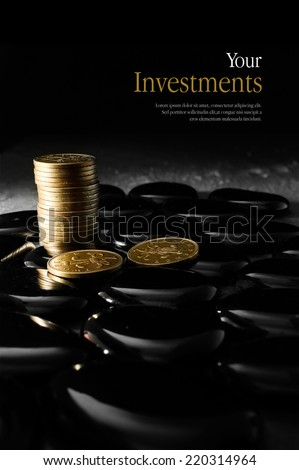 Concept image for pensions and investments. Creatively lit stacked currency coins symbolising investment. Copy space. - stock photo