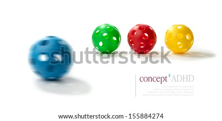 Concept image illustrating Attention Deficit Hyperactivity Disorder (ADHD). Spinning blue plastic ball with the illusion of two eyes and mouth in foreground with normal balls in background.Copy space. - stock photo