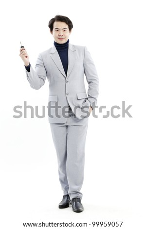 concept image of a businessman holding a key