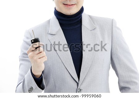 concept image of a businessman holding a key - stock photo