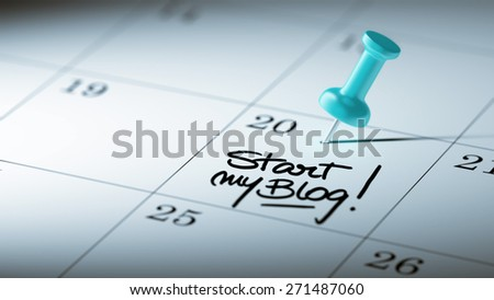 Concept image of a Calendar with a blue push pin. Closeup shot of a thumbtack attached. The words Start my Blog written on a white notebook to remind you an important appointment. - stock photo