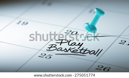 Concept image of a Calendar with a blue push pin. Closeup shot of a thumbtack attached. The words Play Basketball written on a white notebook to remind you an important appointment. - stock photo