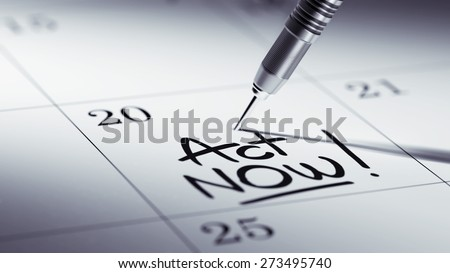 Concept image of a Calendar with a golden dart stick. The words Act Now written on a white notebook to remind you an important appointment.