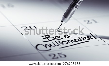 Concept image of a Calendar with a golden dart stick. The words Be a millionaire written on a white notebook to remind you an important appointment. - stock photo