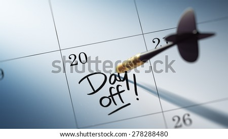 Concept image of a Calendar with a golden dart stick. The words Day off written on a white notebook to remind you an important appointment.