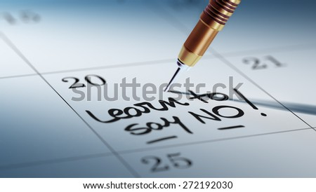 Concept image of a Calendar with a golden dart stick. The words Learn to say no written on a white notebook to remind you an important appointment. - stock photo