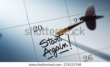 Concept image of a Calendar with a golden dart stick. The words Start Again written on a white notebook to remind you an important appointment. - stock photo