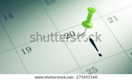 Concept image of a Calendar with a green push pin. Closeup shot of a thumbtack attached.