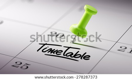 Concept image of a Calendar with a green push pin. Closeup shot of a thumbtack attached. The words Timetable written on a white notebook to remind you an important appointment.
