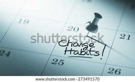 Concept image of a Calendar with a push pin. Closeup shot of a thumbtack attached. The words Change Habits written on a white notebook to remind you an important appointment. - stock photo