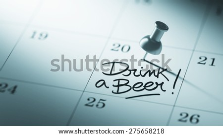 Concept image of a Calendar with a push pin. Closeup shot of a thumbtack attached. The words Drink a beer written on a white notebook to remind you an important appointment. - stock photo
