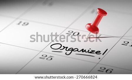 Concept image of a Calendar with a red push pin. Closeup shot of a thumbtack attached. The words Organize written on a white notebook to remind you an important appointment. - stock photo