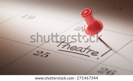 Concept image of a Calendar with a red push pin. Closeup shot of a thumbtack attached. The words Theatre written on a white notebook to remind you an important appointment.