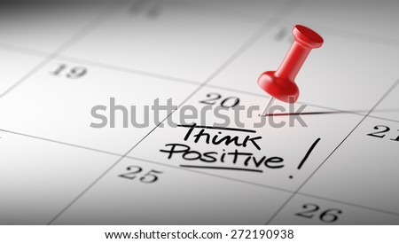 Concept image of a Calendar with a red push pin. Closeup shot of a thumbtack attached. The words Think positive written on a white notebook to remind you an important appointment. - stock photo
