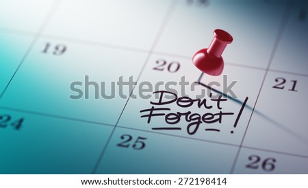 Concept image of a Calendar with a red push pin. Closeup shot of a thumbtack attached. The words Don`t Forget written on a white notebook to remind you an important appointment. - stock photo