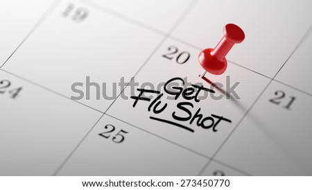 Concept image of a Calendar with a red push pin. Closeup shot of a thumbtack attached. The words Get Flu Shot written on a white notebook to remind you an important appointment. - stock photo