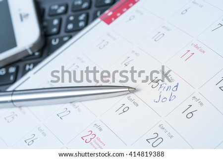 Concept image of a Calendar with a red push pin. Closeup shot of a thumbtack attached. The words Find New Job written on a white notebook to remind you an important appointment.