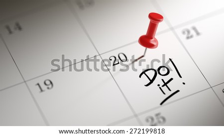Concept image of a Calendar with a red push pin. Closeup shot of a thumbtack attached. The words Do it written on a white notebook to remind you an important appointment. - stock photo
