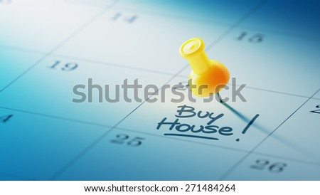 Concept image of a Calendar with a yellow push pin. Closeup shot of a thumbtack attached. The words Buy House written on a white notebook to remind you an important appointment. - stock photo