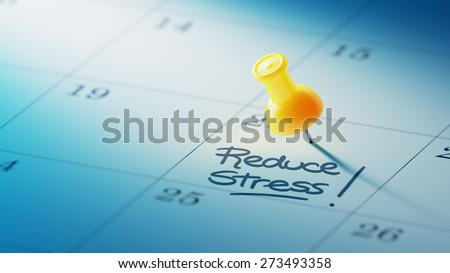 Concept image of a Calendar with a yellow push pin. Closeup shot of a thumbtack attached. The words Reduce Stress written on a white notebook to remind you an important appointment. - stock photo
