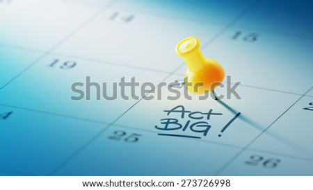 Concept image of a Calendar with a yellow push pin. Closeup shot of a thumbtack attached. The words Act BIG written on a white notebook to remind you an important appointment. - stock photo