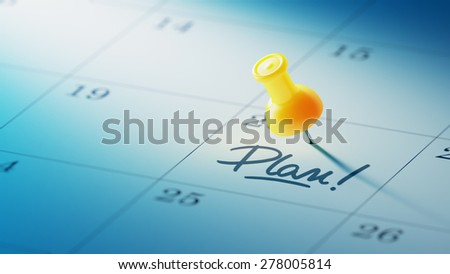 Concept image of a Calendar with a yellow push pin. Closeup shot of a thumbtack attached. The words Plan written on a white notebook to remind you an important appointment. - stock photo